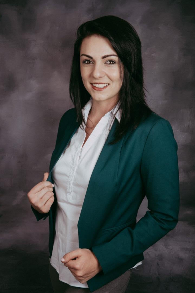 A portait photo of Mari-Louise du Plessis who is a real estate agent in Namibia.